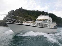 Moonraker 36 Flybridge version heading out to sea